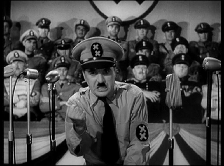 Chaplin, as Hynkel, bursts loudly into frame.