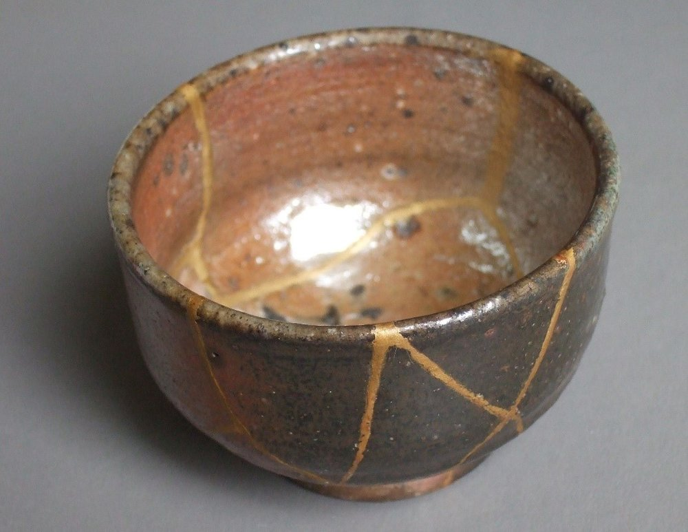 An example of Kintsugi, where a broken cup was repaired while drawing attention to the repairs.