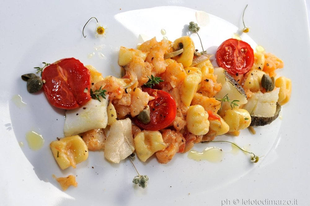Potato gnocchi with salt cod sauce and salty capers.jpg