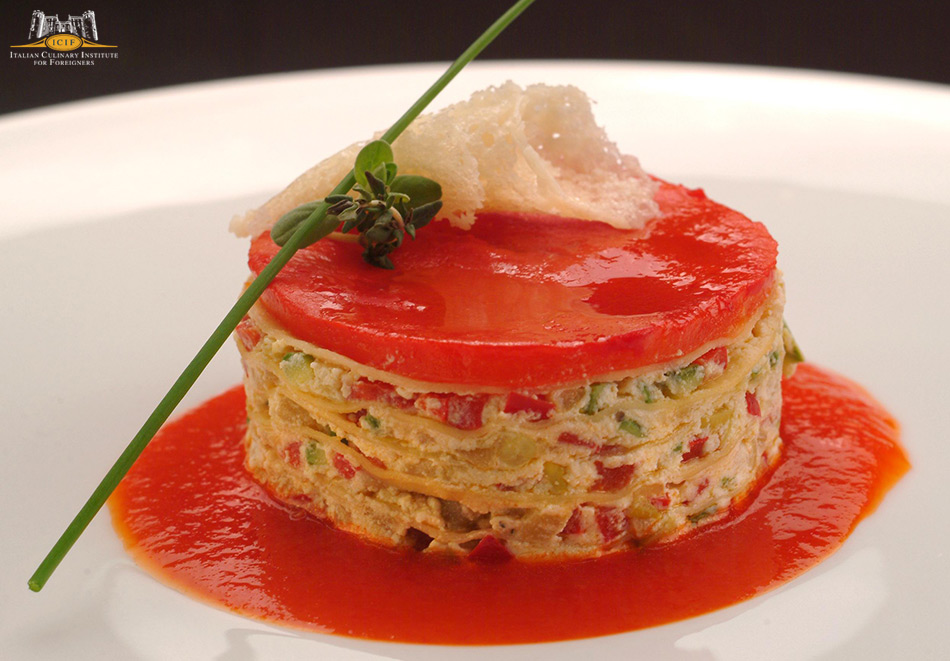 Lasagna stuffed with vegetables served on a warm cream of red sweet peppers.jpg
