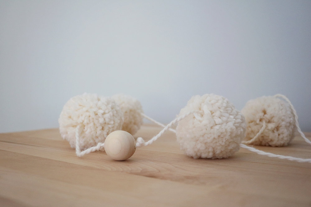 DIY Neutral Pom Pom + Wooden Bead Garland | root + dwell