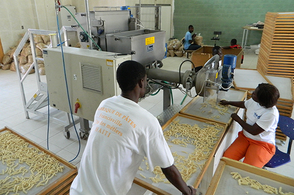 Workers at St. Francisville oversee pasta production.