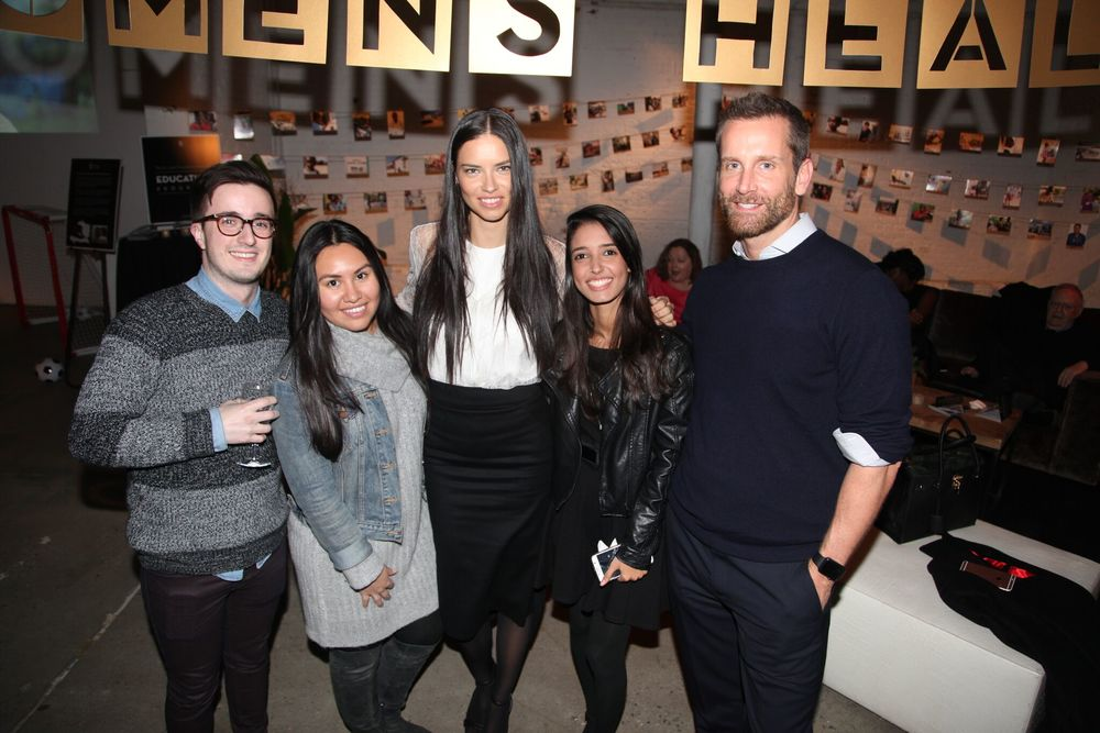 Attendees of the New York City fundraising party join St. Luke supporter Adriana Lima