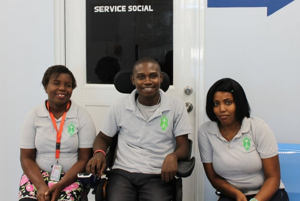 Yolette Senat (left), Wilflo Flontus (center), and Rachelle Petiote work diligently to help their most vulnerable patients at St. Luke Hospital.