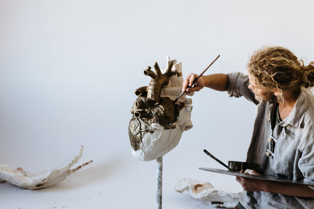 Chapman Hamborg , applying bronze paint to his sculpture, commissioned for Bethel Music's album   Have It All   (2016).