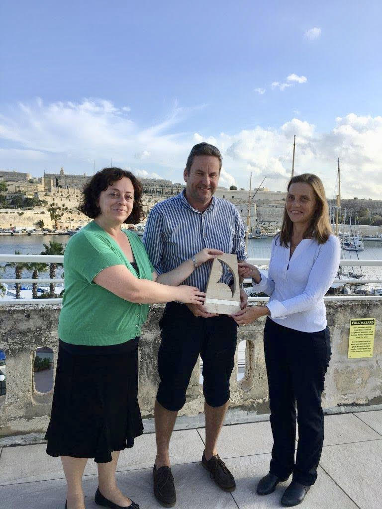 Deputy High Commissioner Suzy McKellar (left) and High Commissioner Julienne Hince present the trophy to Brian Clarke