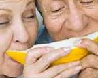 older couple eating mellon