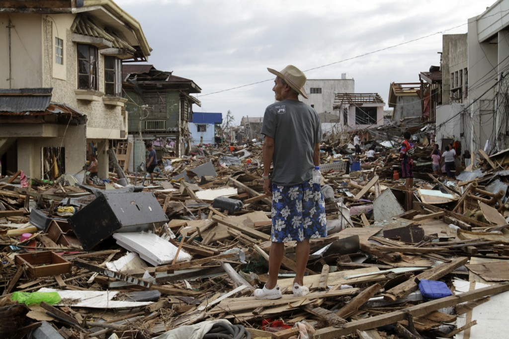A man assessing the damage in Tacloban.