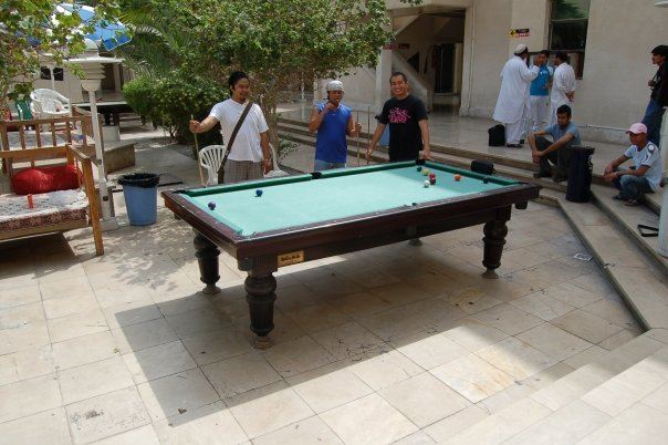 Biding their time at the billiards in the Farabi Hotel.