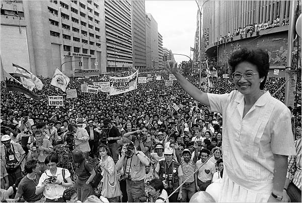 Corazon Aquino waves to the crowds at the victorious conclusion of EDSA