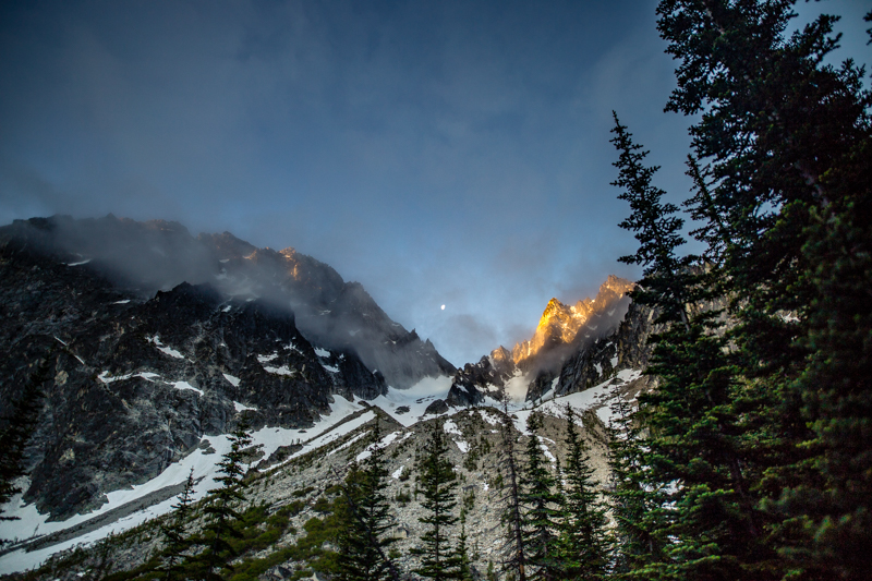 The sunrise just catching Colchuck Peak while the moon still shines