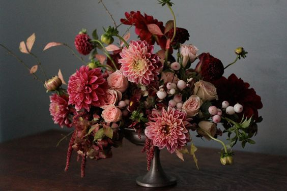 A small compote filled with the richest colors and textures. Amaranthus drips down the sides of this summer arrangement that looks good enough to eat.