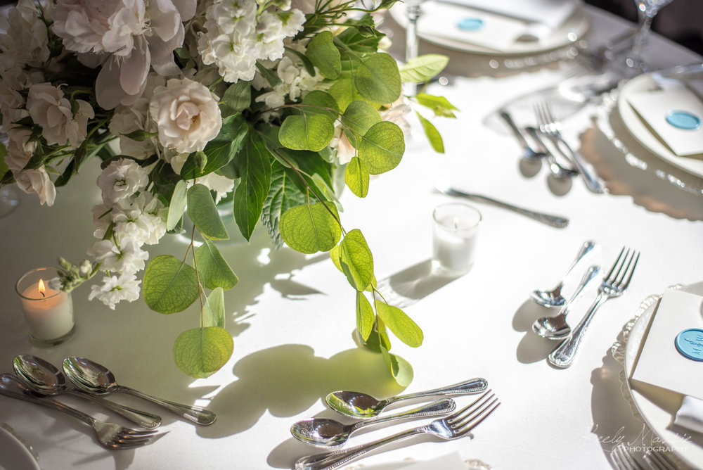 Centerpiece with Eucalyptus by Country Garden Weddings.jpg
