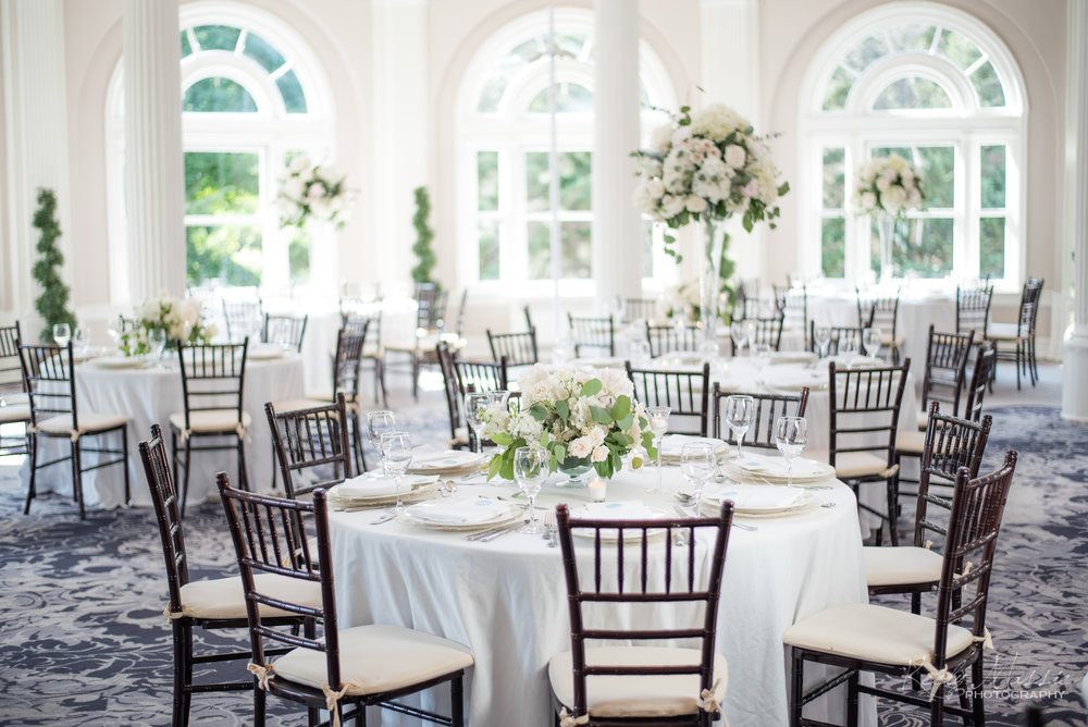 Tall and Low Centerpieces by Country Garden Florist.jpg
