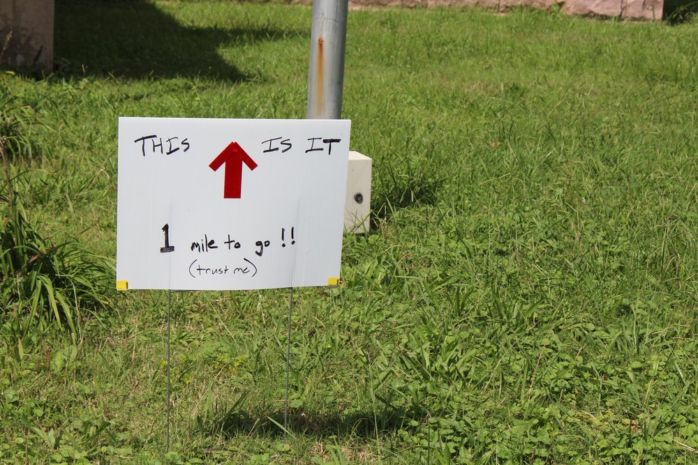 Signs like this would be seen all day, as early as mile 5 - Photo by Susan Brother Yancey