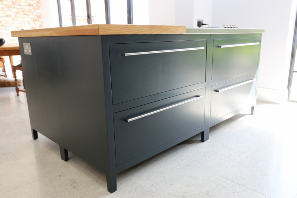Modern kitchen island with soft close drawers as standard