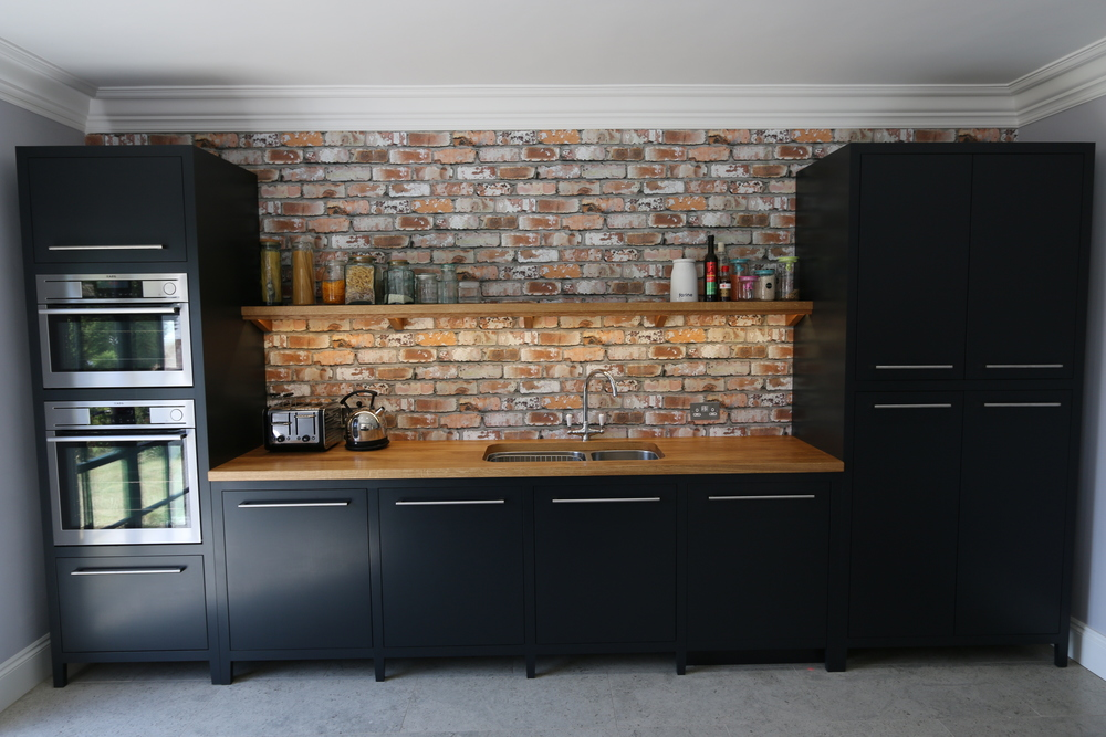 Modern freestanding kitchen in Medway, Kent. Farrow and ball off black.