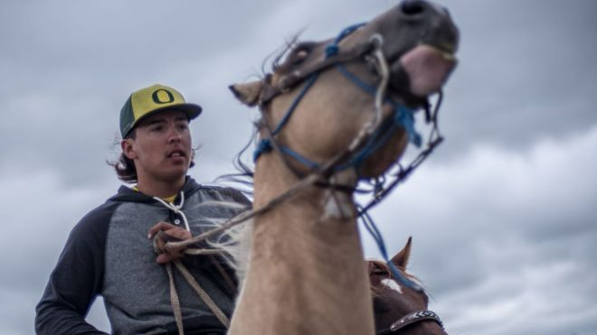 """C.NORTHCOTT A cohort of young men patrol the Red Warrior Camp calling themselves """"spirit riders."""" They spend most of their time running errands and delivering messages. They are excellent riders, often going bareback, sometimes without reins, occasionally galloping in the nearby floodplain. The Sioux people have a long history of horsemanship, defeating the US army repeatedly in pitched horse battles in the 1800s - most famously at the Battle of Little Bighorn, where the invading cavalry commander George Custer was killed."""