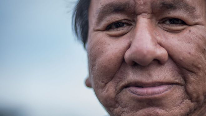 """C.NORTHCOTT Pancho, pictured here, is from the Standing Rock Reservation. He has been protesting against the pipeline since April, and worries the camps are becoming overcrowded and that local supplies are overstretched. """"We know this place can't handle many more people,"""" he said, standing in the Sacred Stone Camp. """"Resources are stretched. Our community does not have a lot of money."""""""