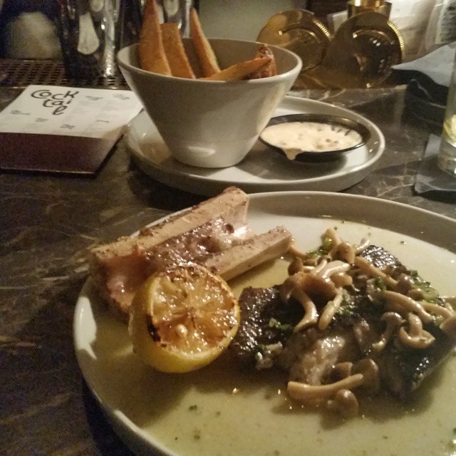 Bone marrow + black cod with fries in the background. @starrykitchen  (at Cadet)