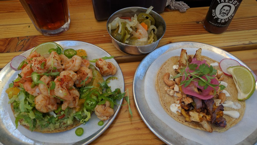 The shrimp tostada is bountiful and the cauliflower taco is incredible flavorful