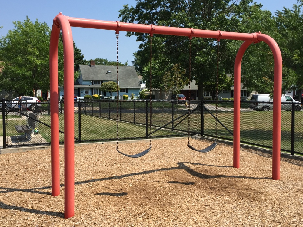 Swings at Red Maple Drive Playground