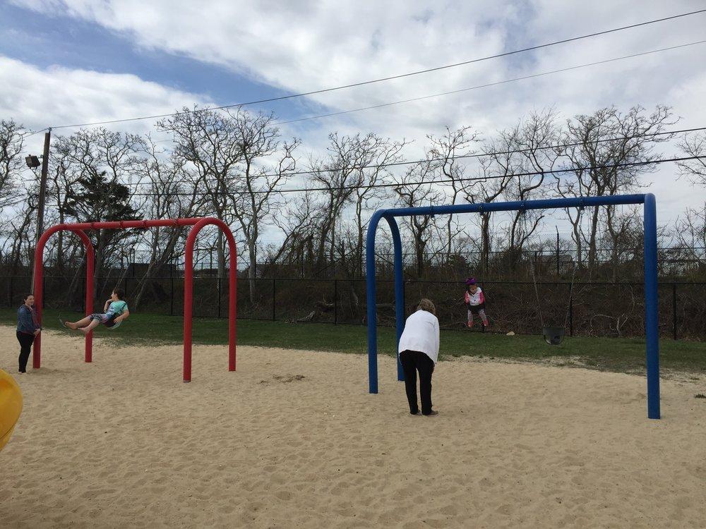 Swings at East Islip Marina Park Playground
