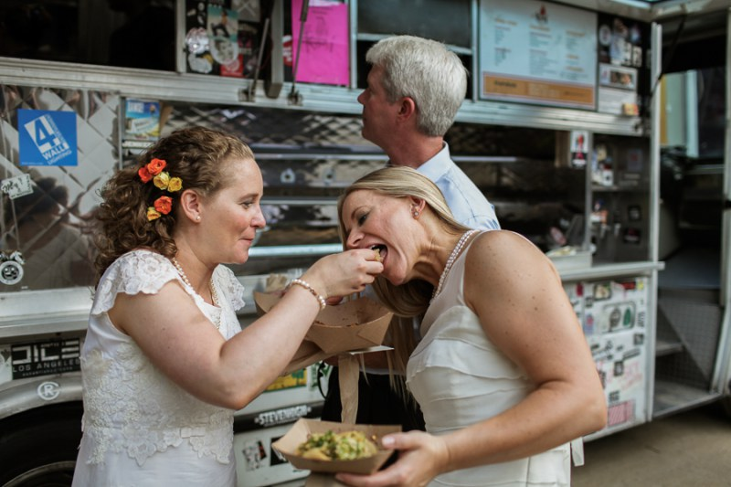 Brides-feeding-each-other-tacos.jpg