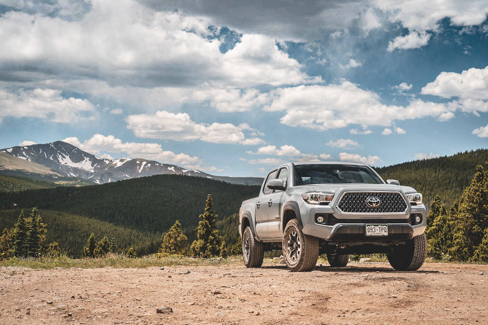 Cement grey Toyota Tacoma in mountains