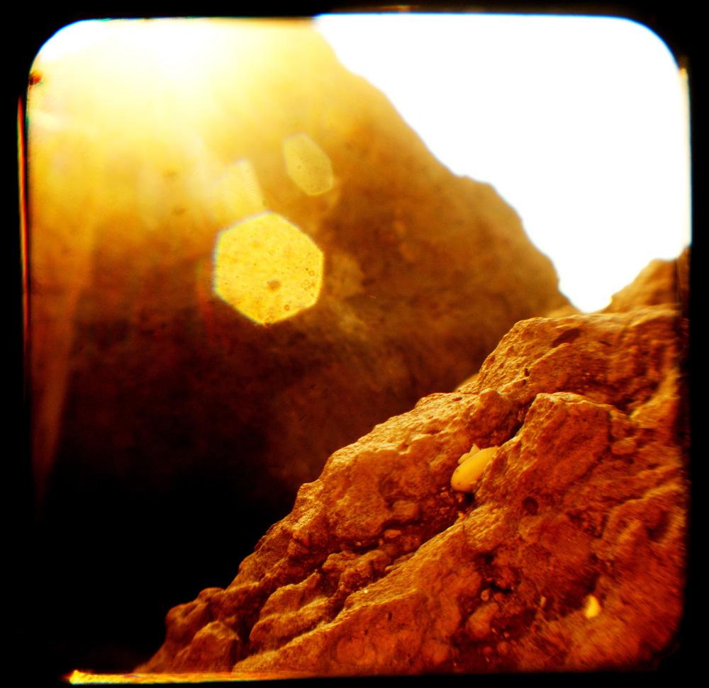 Beach Rocks Bathed In Blinding Sunlight.jpg