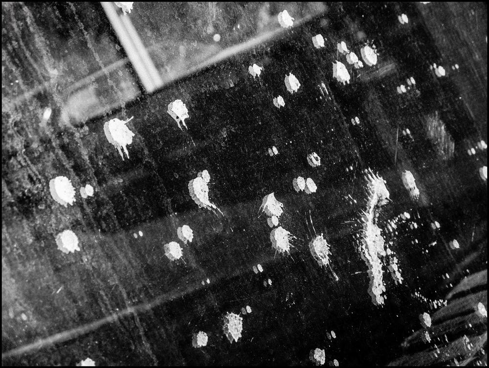 Car Reflected In Splattered Window_edited-1.jpg