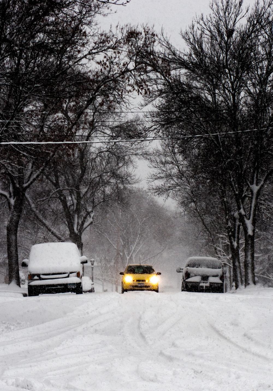 Yellow Car Through The Snow.jpg