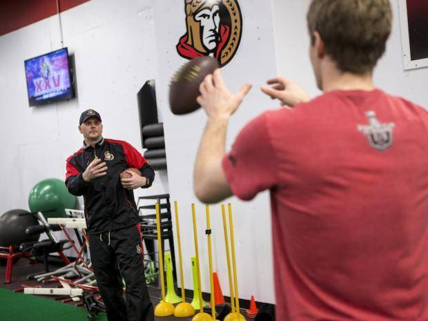 Conditioning coach Chris Schwarz works with Ottawa Senator forward Kyle Turris at the CTC on March 14, 2017.