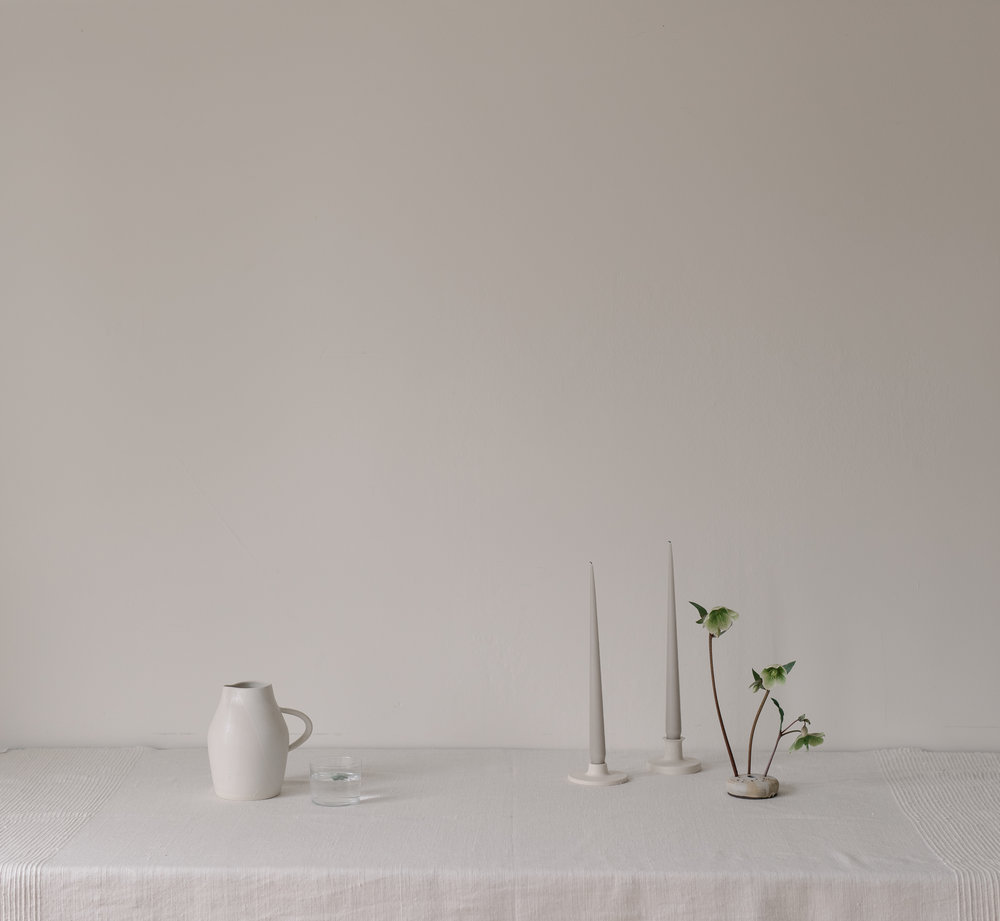 white trefoil pitcher, candlesticks, flower frog