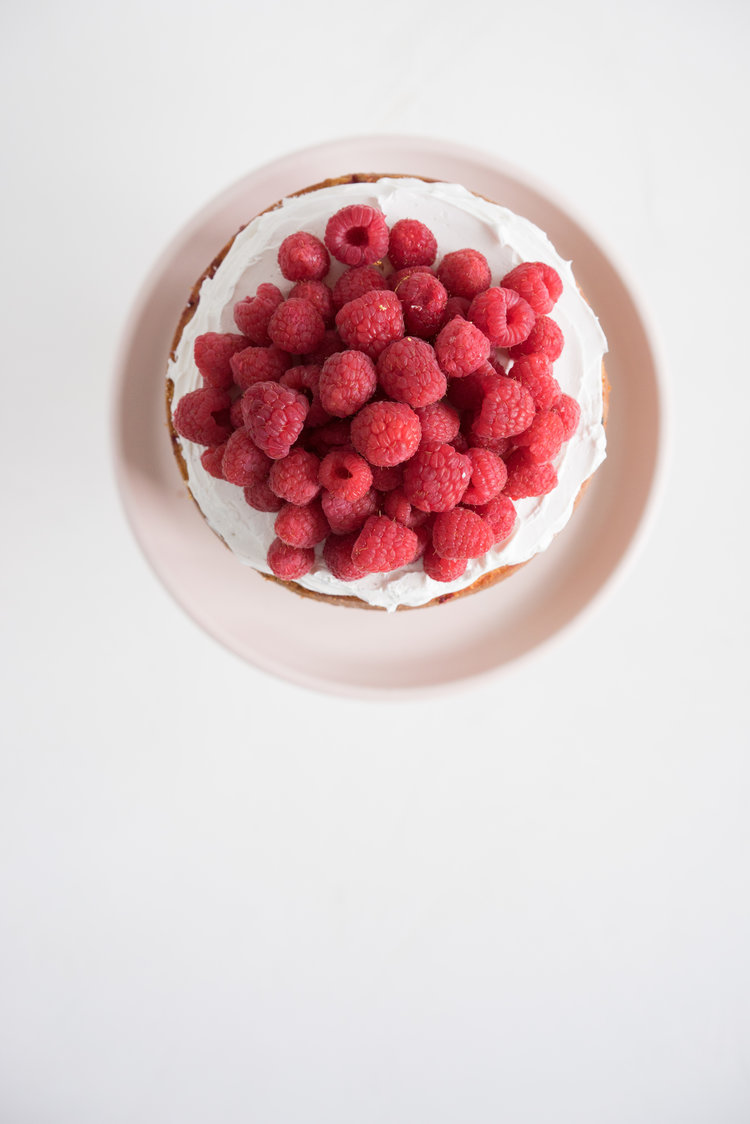 Raspberry+and+Almond+cake+-+a+perfectly+dense+almond+meal+cake,+lightly+scented+with+lemon,+and+with+a+layer+of+fresh+raspberries+baked+into+each+layer.+Layered+with+vanilla+swiss+meringue+buttercream+and+more+fresh+r-3.jpg