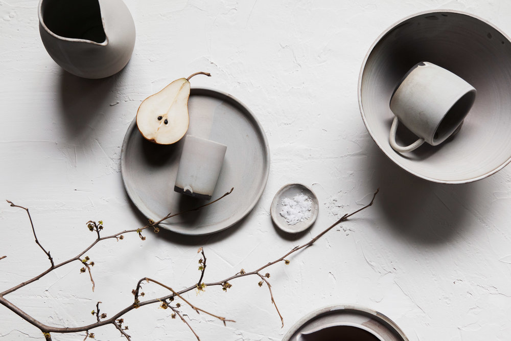assorted ceramics in matte grey on brown clay