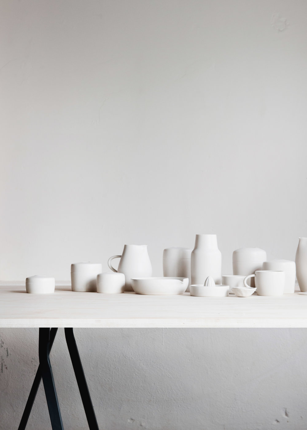 assorted ceramics in matte white on white clay