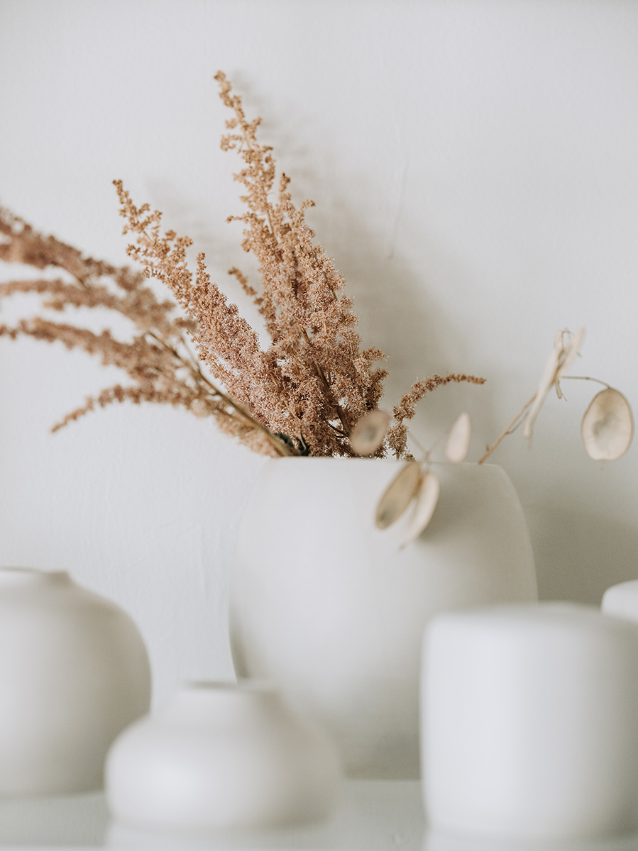 assorted matte white vases