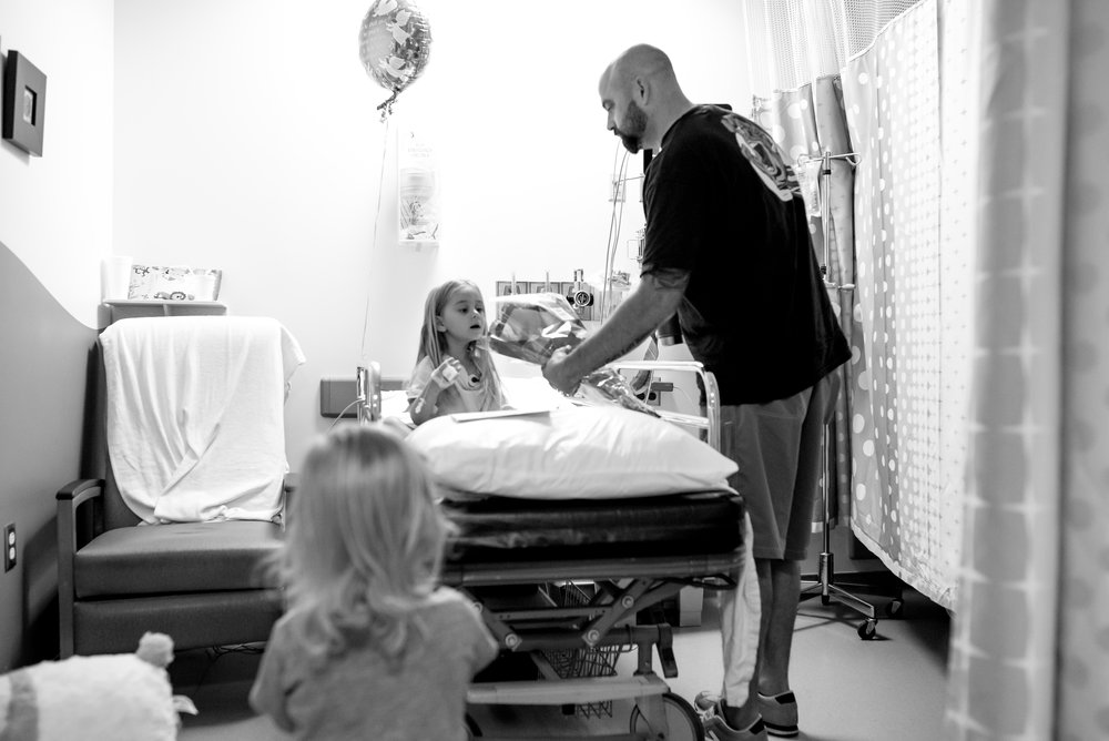 Dad presents flowers to daughter in hospital
