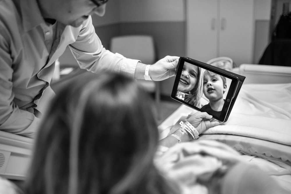 Mom and Dad FaceTime kids while in hospital