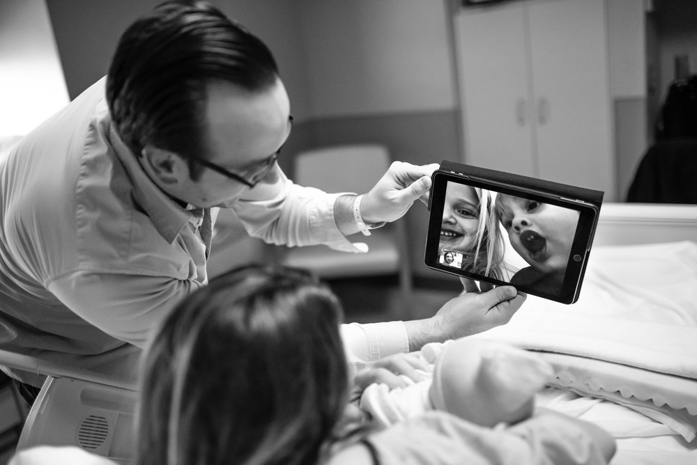 Parents FaceTime children in hospital with newborn