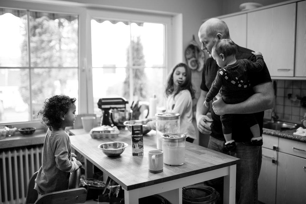 Dad and kids make pancakes