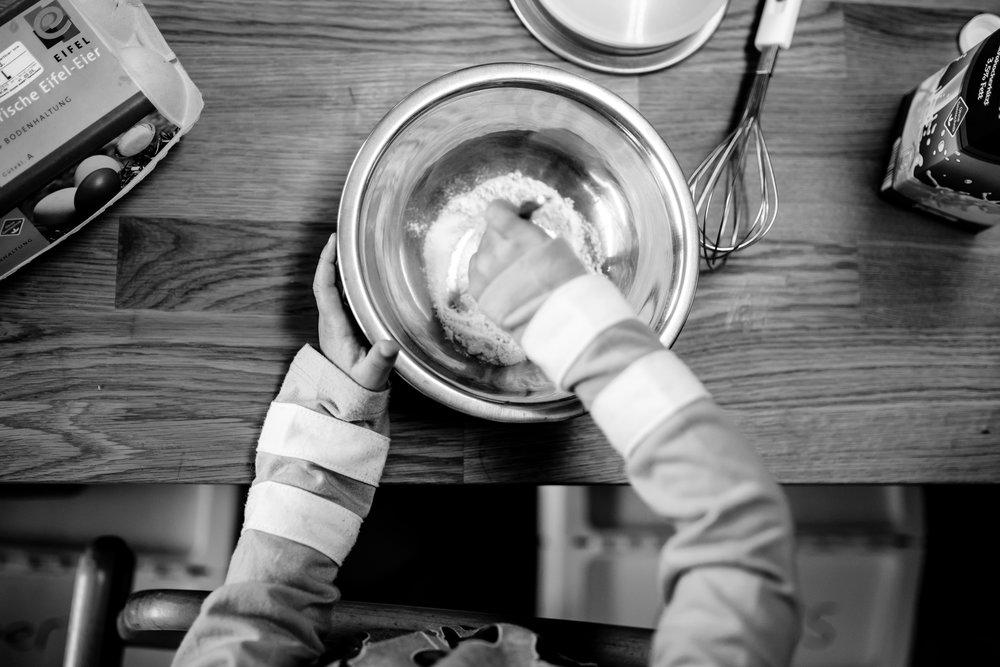 Girl mixes flour in bowl