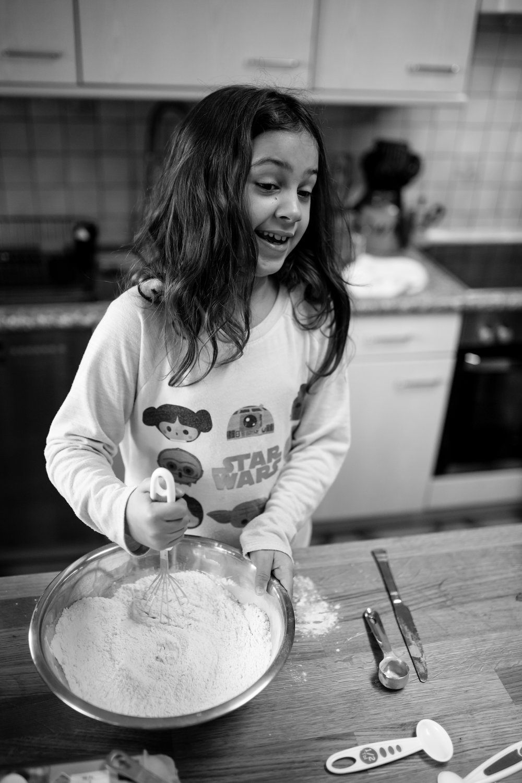 Girl talks and mixes pancake mix