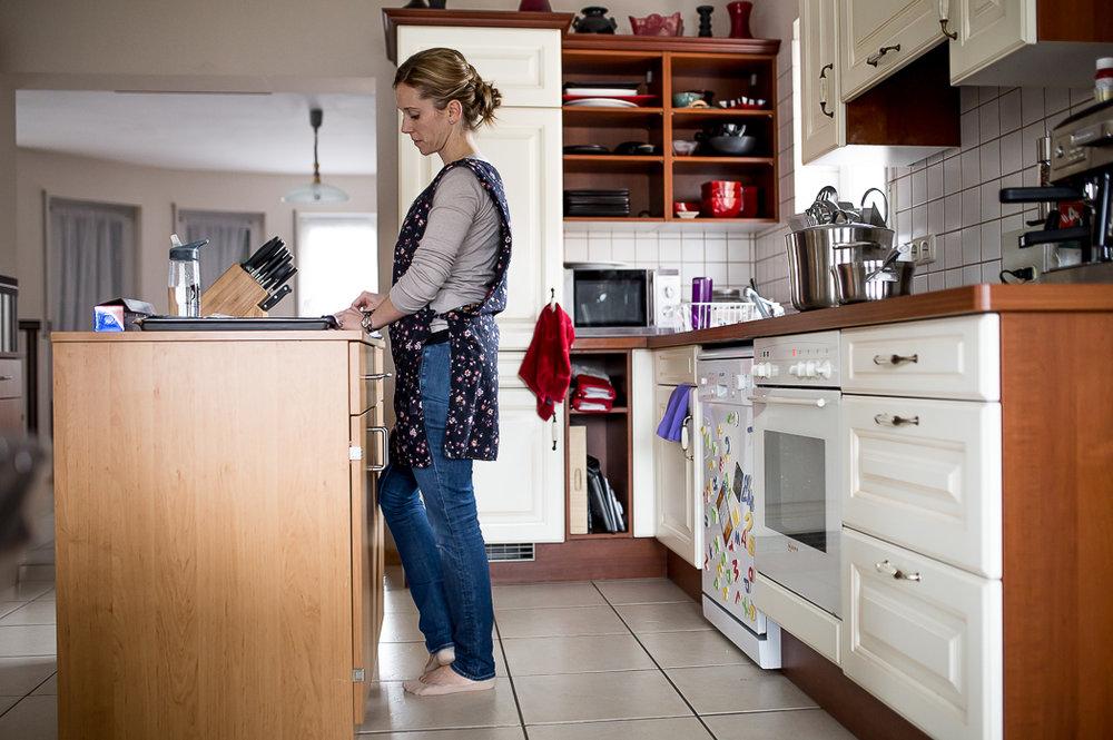 Woman cooks at kitchen island