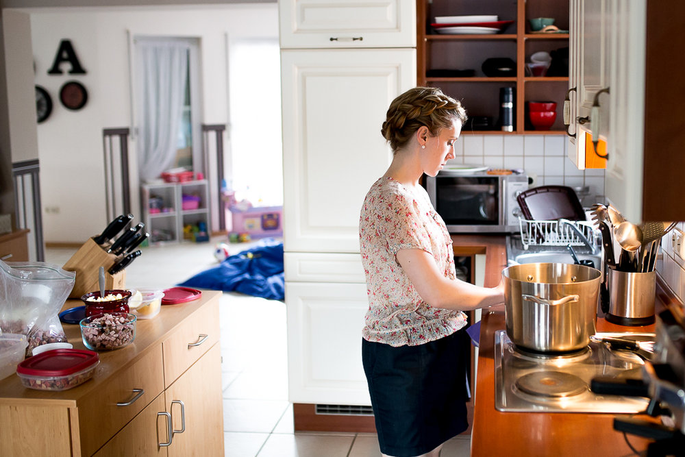 Woman cooks at stove