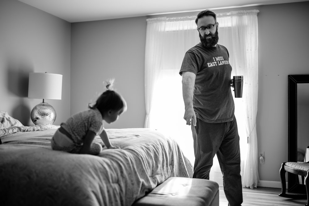 Dad points to tell daughter to how to get down off of bed