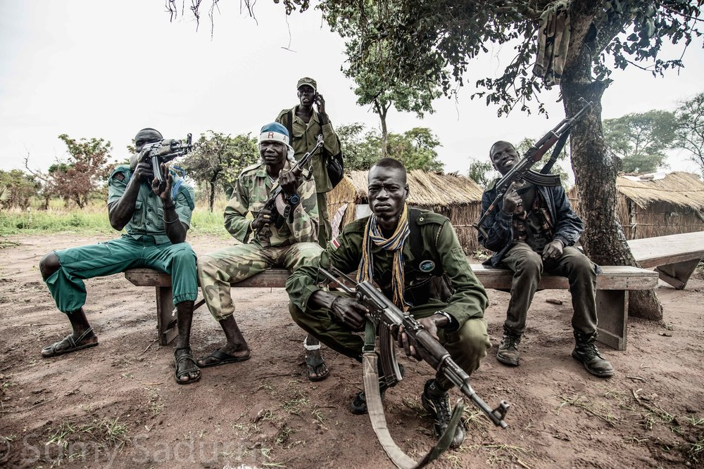 Print 3: A group of rebel fighters from the Sudan People's Liberation Army - In Opposition (SPLA-IO) before they go on patrol to look for government forces, South Sudan.