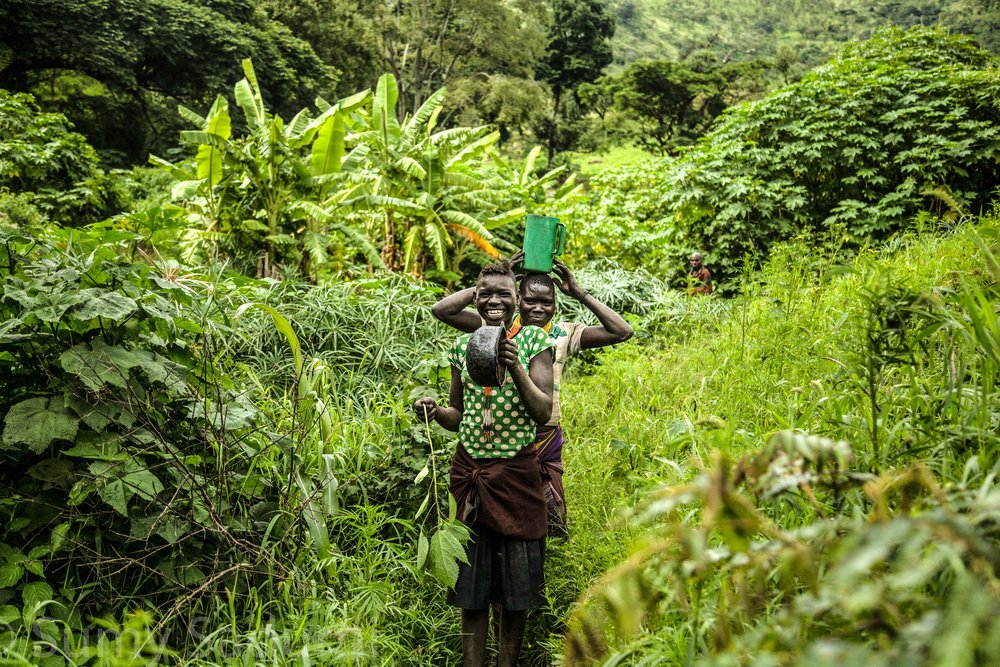 Print 10: Karamojong girls on their way to the local market at the base of Mount Morungole, in Northern Uganda.