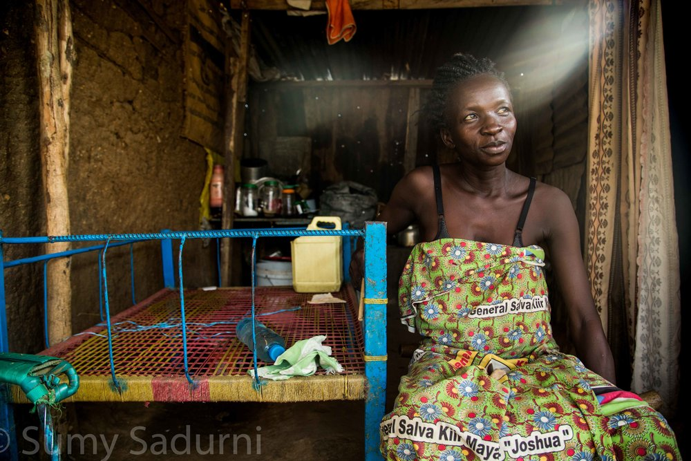 Print 13: Mary Nyoka lives in Juba, South Sudan. She fled her village in Lanya when there was fighting, but unlike the rest of her family, she was unable to make it to Uganda and feels like she can't leave her house for fear of being attacked.